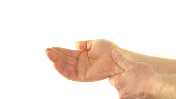 snížení bolesti s vlastní masáž zápěstí na bílém pozadí