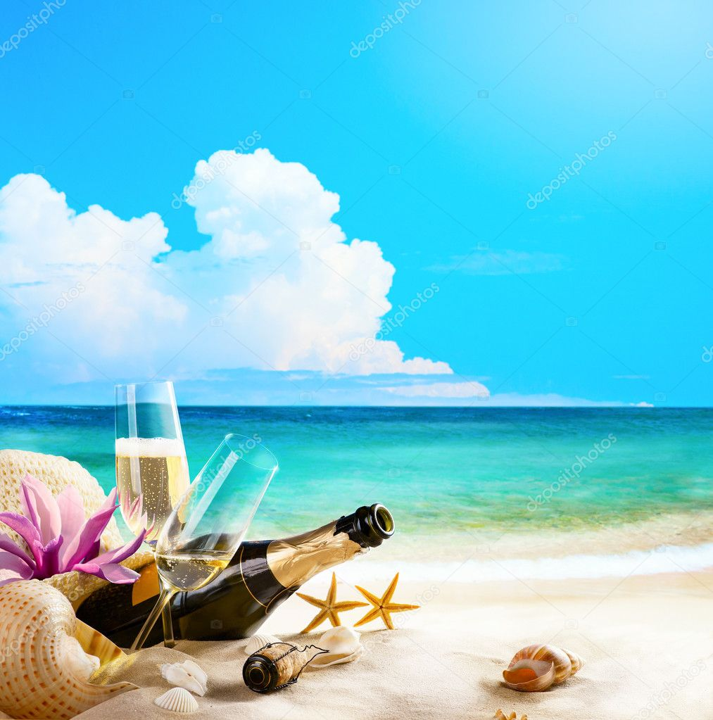 Art romantic sea beach. wine Glasses and Champagne Bottle on san