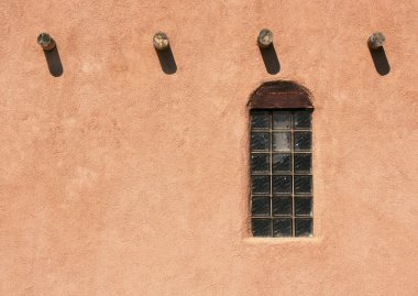 Adobe wall, with beam ends