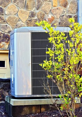 Air Conditioner / Heating Unit on a House