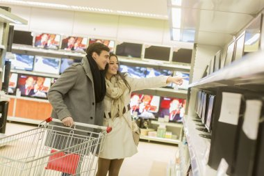 Young couple shopping electronics