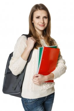 woman wearing a backpack and holding botebooks