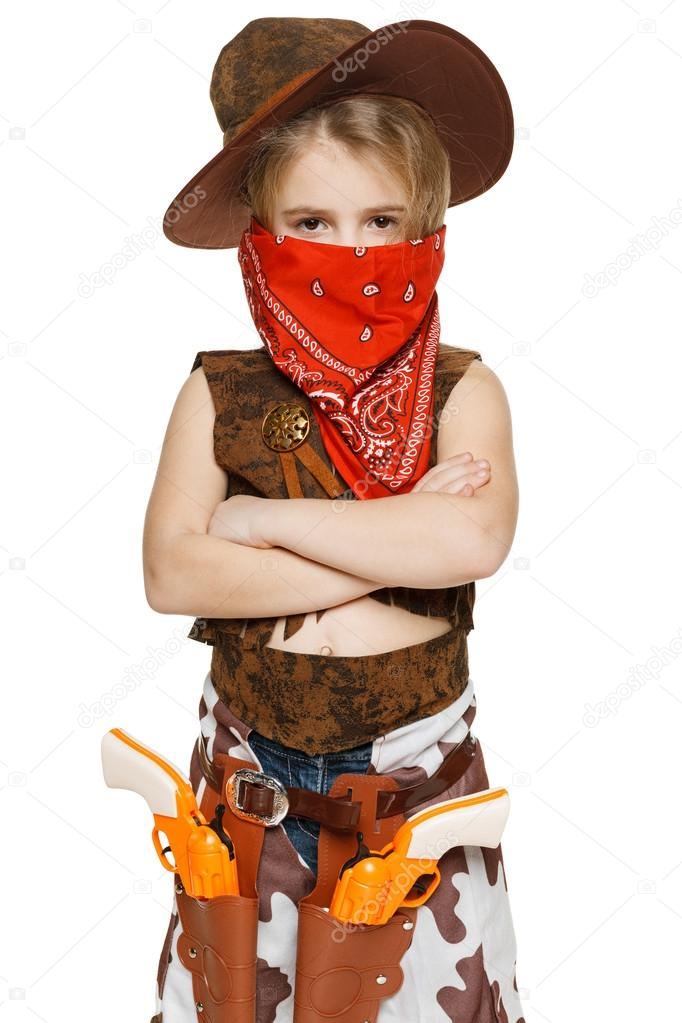 Girl Wearing Cowboy Costume And Bandana Stock Photo