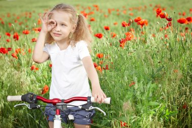Happy smiling little girl with bicycle
