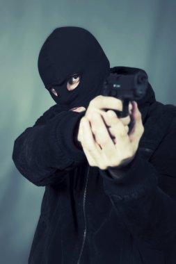 black dressed man with gun