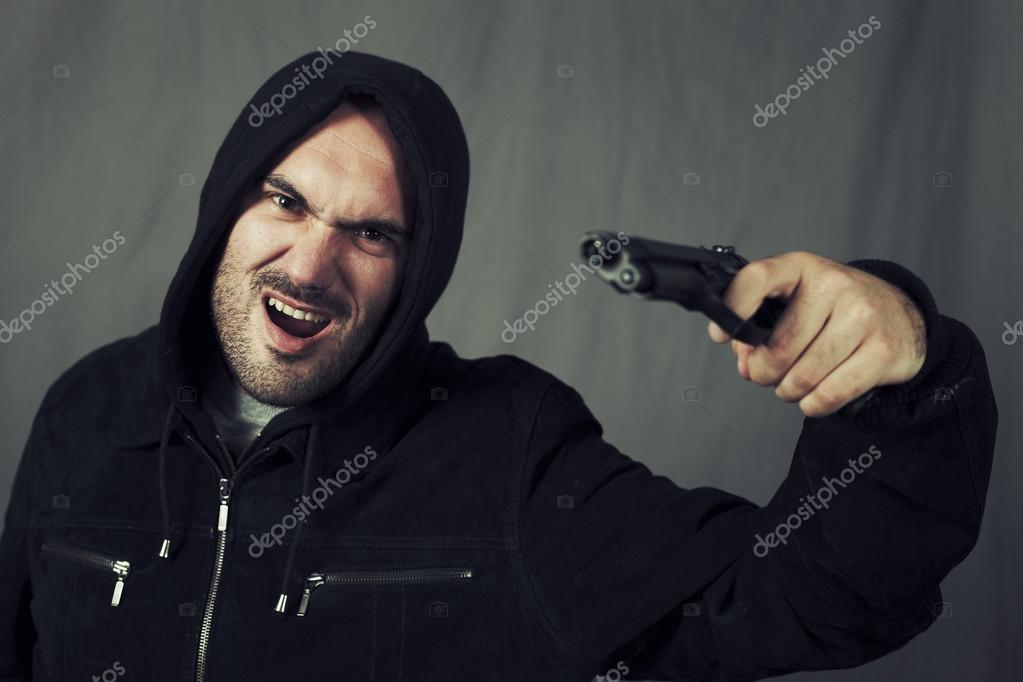 Man with black gun and special photographic processing