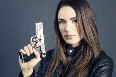 Dangerous woman holding up her gun stock vector