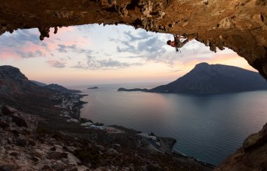 Silhouette of a rock climber against picturesque view of Telendos Island at sunset