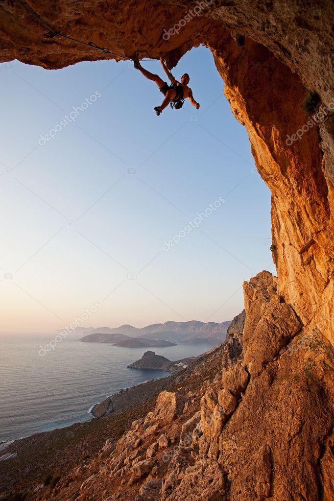 Rock climber at sunset, Kalymnos Island, Greece stock vector