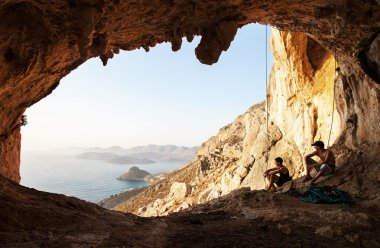 Two rock climbers having a rest. Kalymnos Island, Greece.