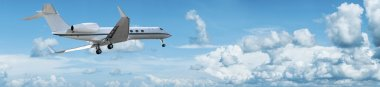 Private jet is maneuvering for landing. Panoramic composition.