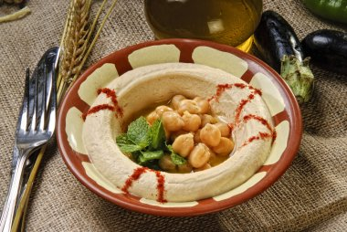 Plate of Arabic traditional hummus with peas grains