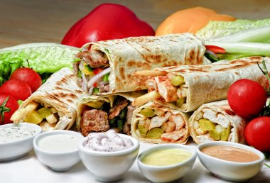 Eastern traditional shawarma plate with sauce