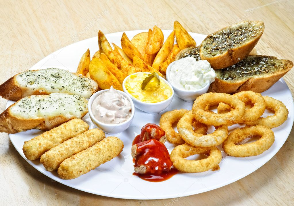 Plate with different kinds of appetizers stock photo for Canape 4 kinds