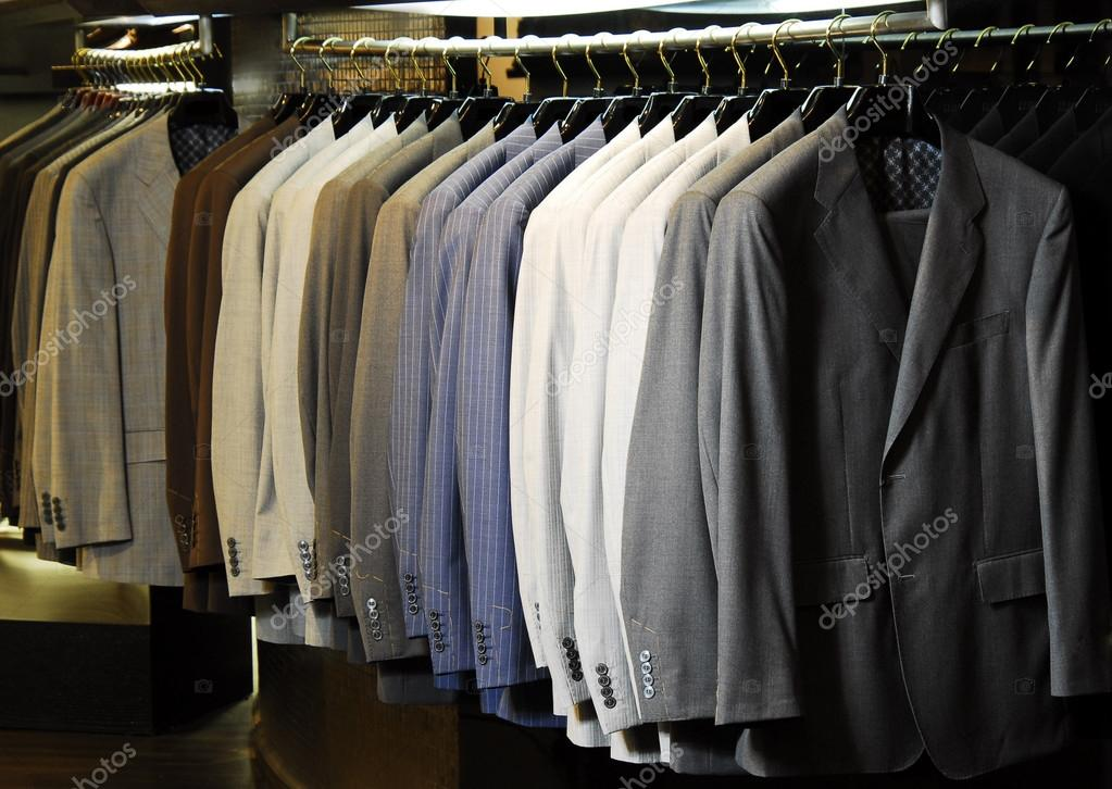 Raw of different colors man's jackets hanging on apparel.