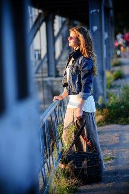 Vintage way dressed yang beautiful woman walks outdoor in summer time