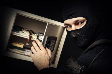 Professional burglar in black ski mask