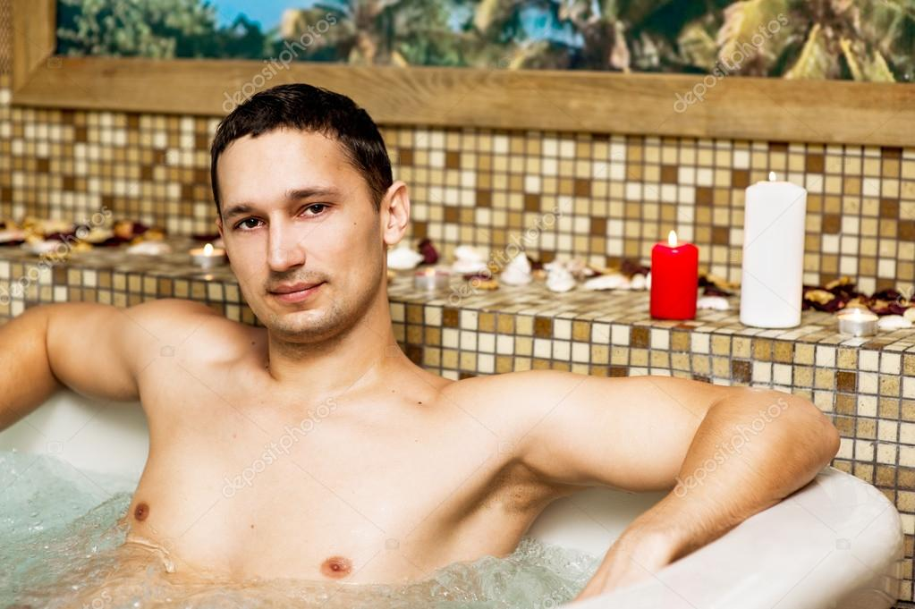 Young man in romantic jacuzzi