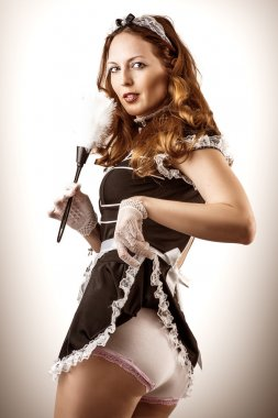 sexy French Maid holding duster