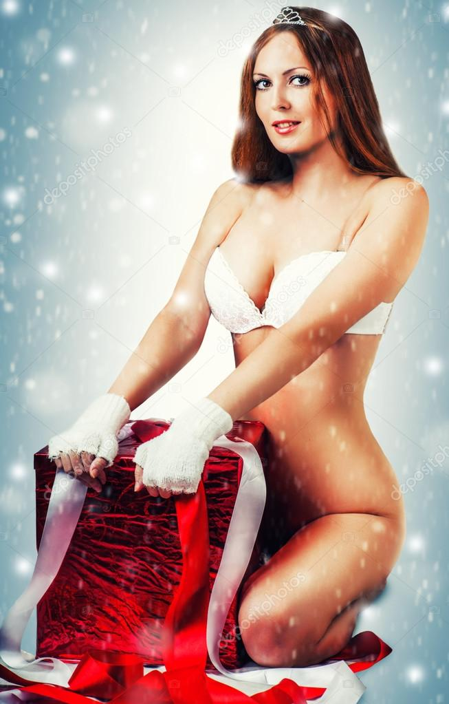 Sexy christmas woman with big red xmas gift — Stock Photo ...