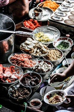 Local sell food items at Damnoen Saduak floating market