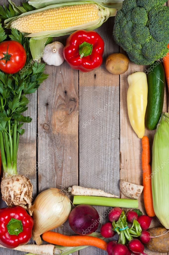 Vegetables on old boards as the background