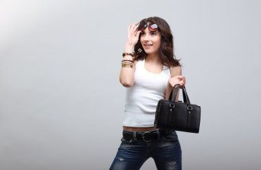 Young girl in jeans.
