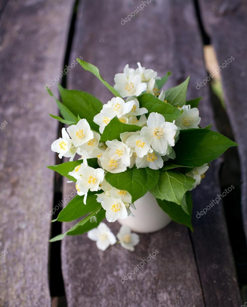 Bunch Of Jasmine Flowers On Wooden Garden Table Stock Photo