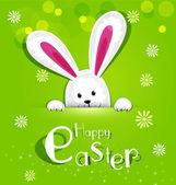 Fényképek Húsvéti nyuszi nézett ki egy zöld háttér vektor