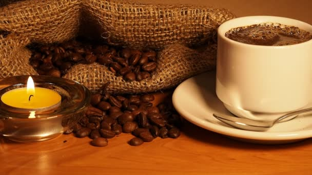 aromantic background with candles, a cup of coffee