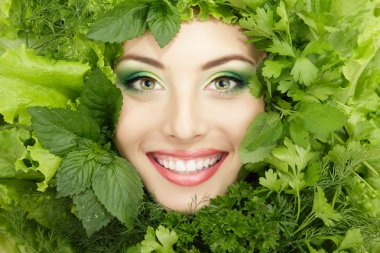 woman beauty face with greens vegetables frame isolated on white