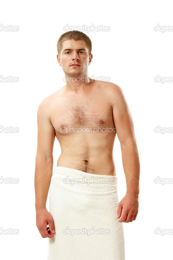 homme jeune bel athl te avec la serviette de bain isol sur blanc photographie khorzhevska. Black Bedroom Furniture Sets. Home Design Ideas