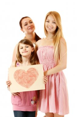 Happy mother with two daughters holding big drawn heart
