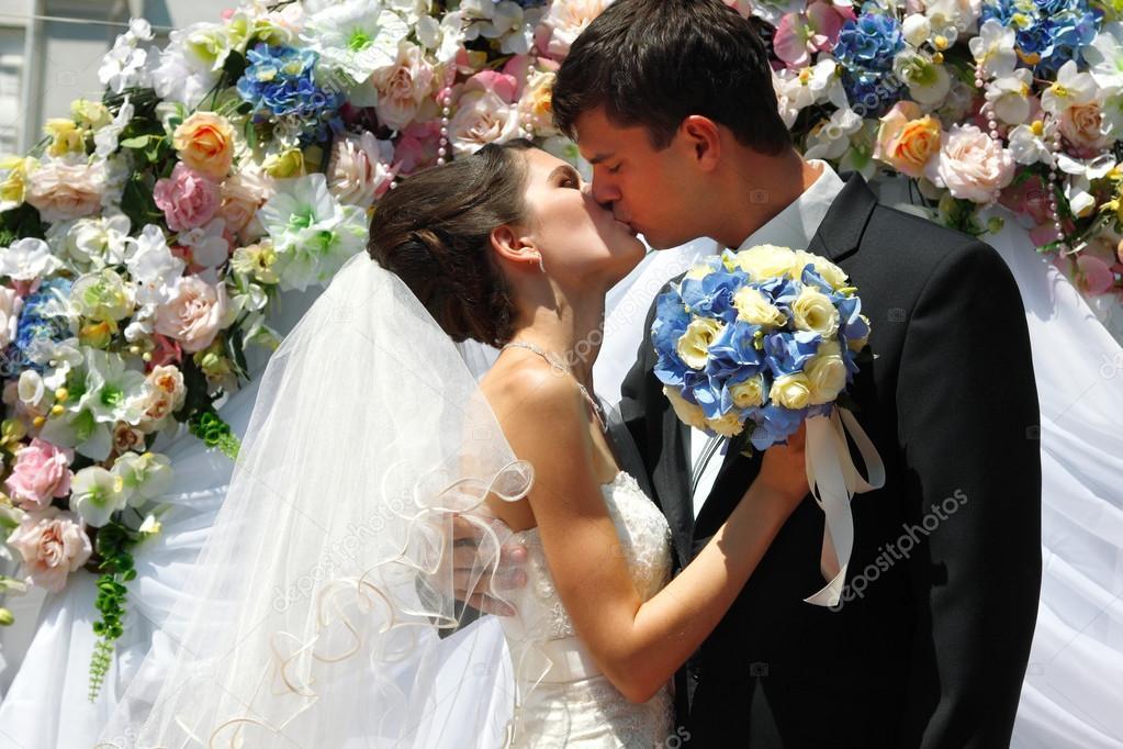 Wedding Ceremony Groom Kiss Bride Stock Photo
