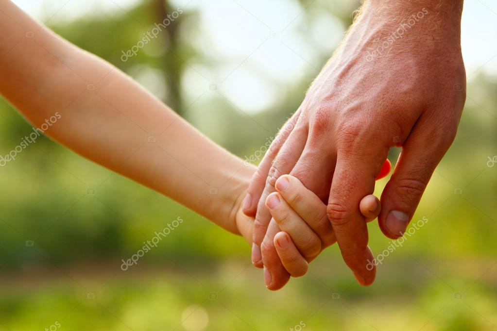 Father's hand lead his child son