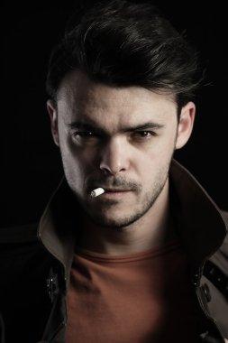 Portrait of a handsome man smoking a cigarette