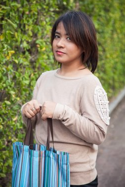 Portrait Asian woman Standing and holding bag