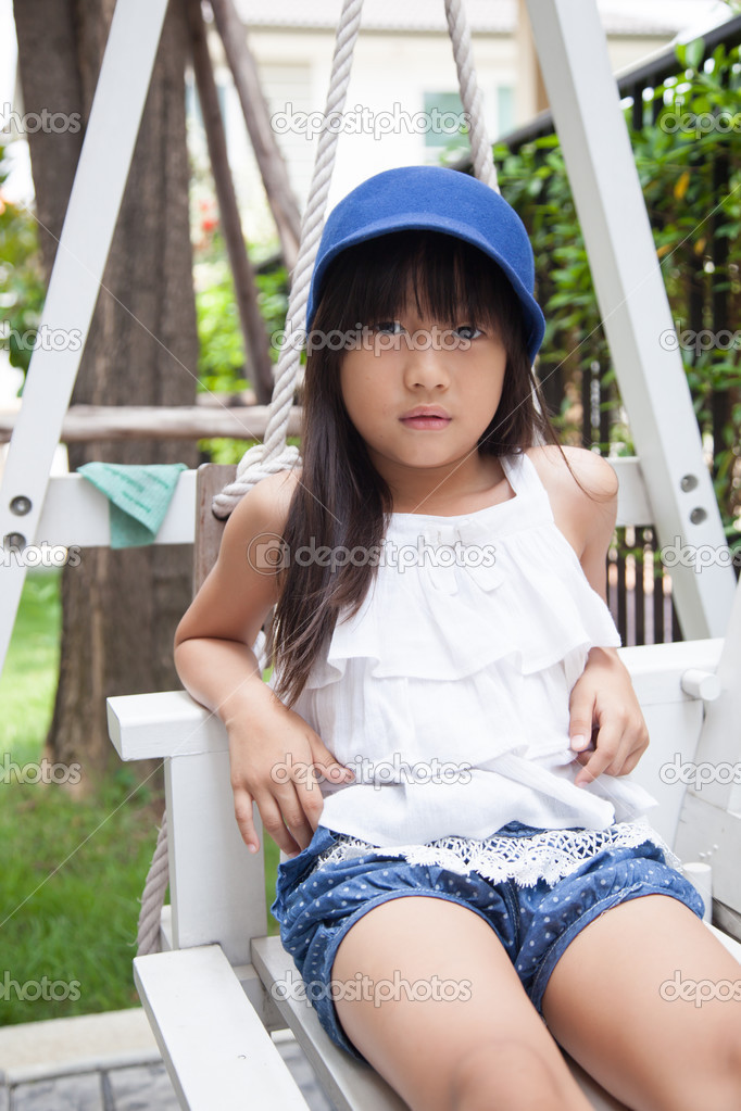 Girl Sitting On A Swing Stock Photo