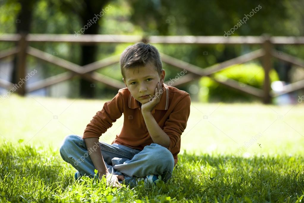 Sad worried little boy