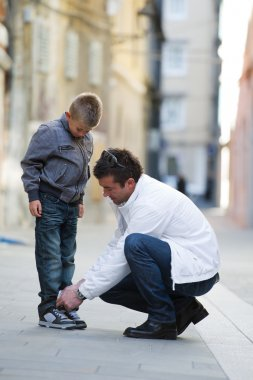 Father helping son
