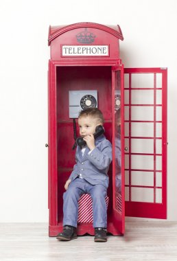 little boy in English red phone