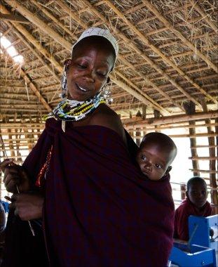 Masai teacher with baby.