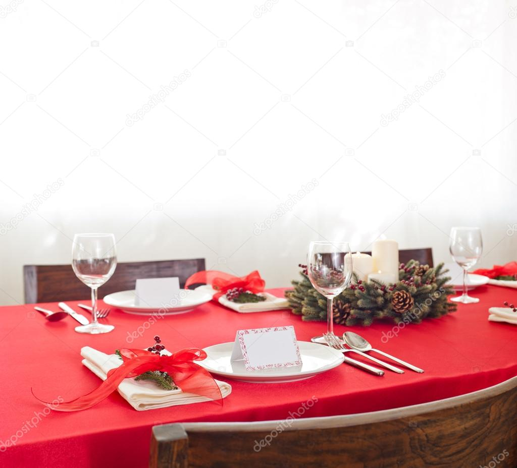 Red Christmas dinner table setup — Stock Photo © a41cats #41740419