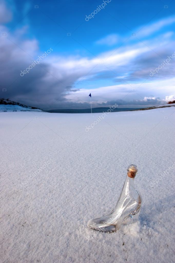 Glass slipper on snow covered golf fairway