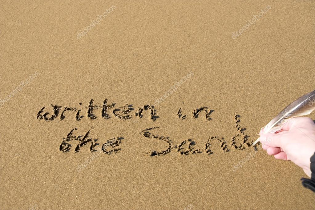 hand written in the sand