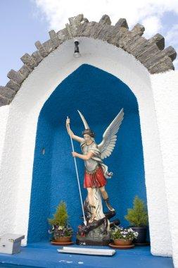 saint michael slaying satan