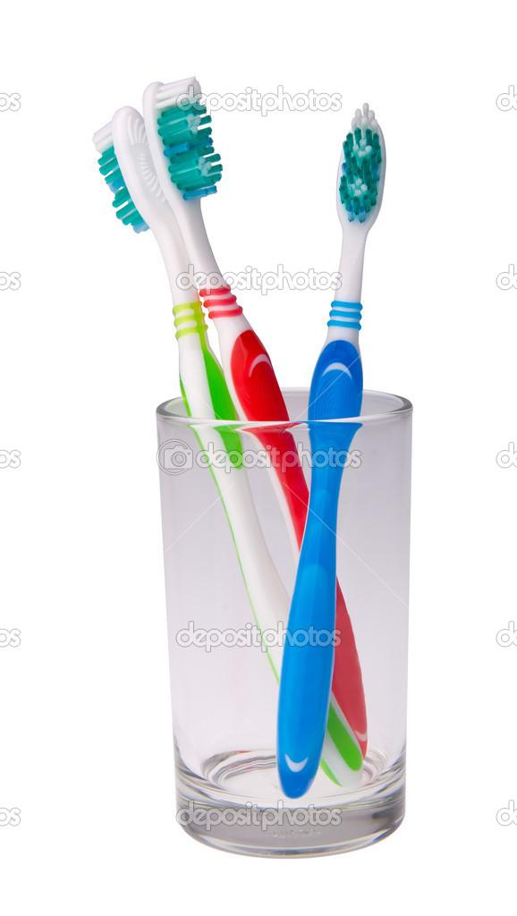 bunte Zahnbürsten in einem Glas auf Hintergrund — Stockfoto ...