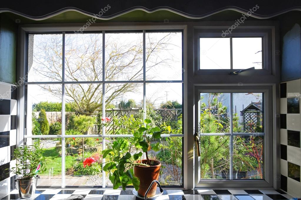 Kitchen window with the view on garden