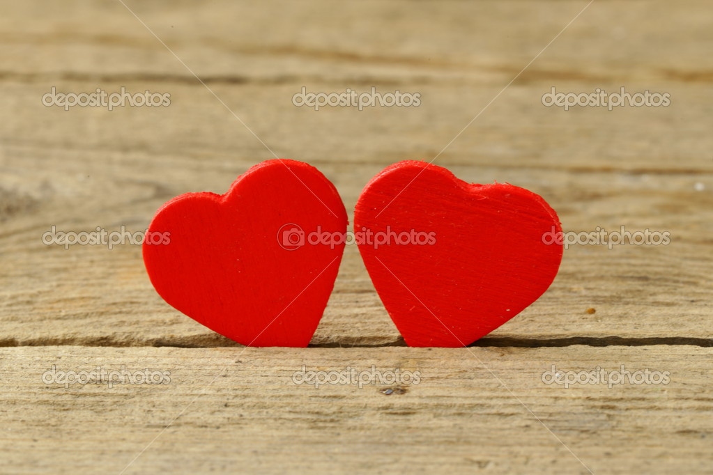 Two Red Heart Symbol Of Love On A Wooden Background Stock Photo