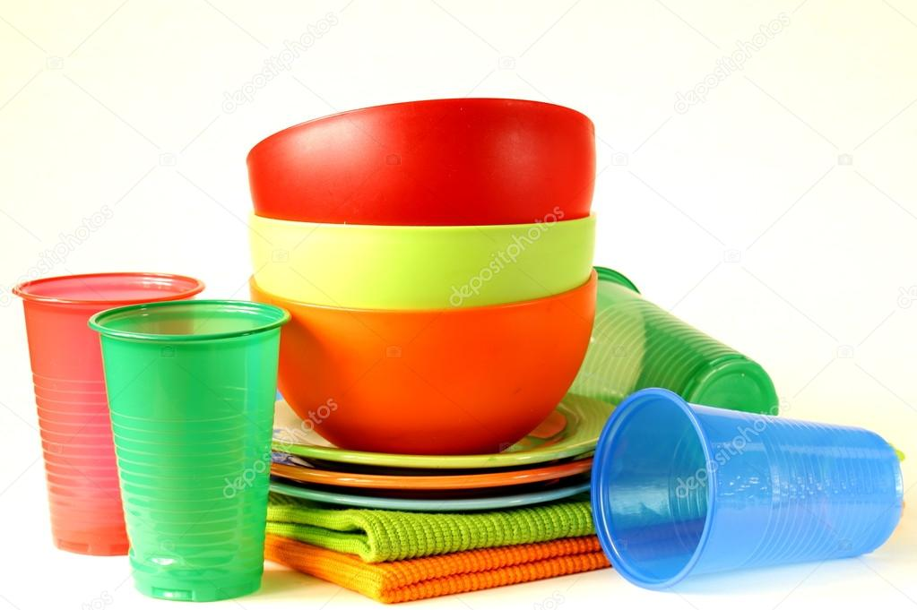 Colored plastic tableware (cups bowls plates) u2014 Photo by Dream79 & Colored plastic tableware (cups bowls plates) u2014 Stock Photo ...